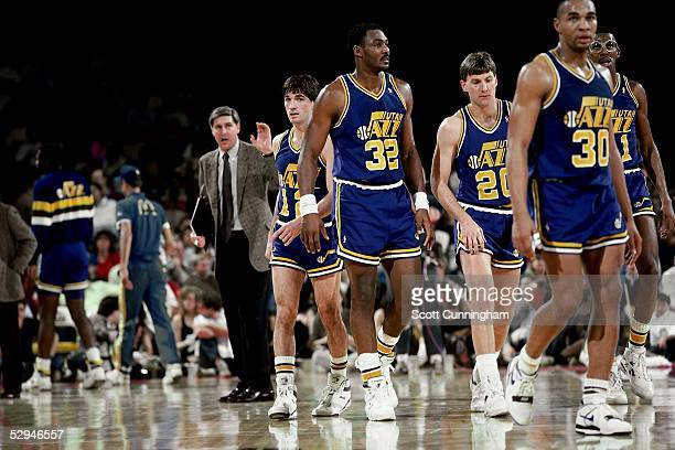 Karl Malone and John Stockton of the Utah Jazz head onto court after meeting with head coach Jerry Sloan against the Atlanta Hawks at the Omni circa...