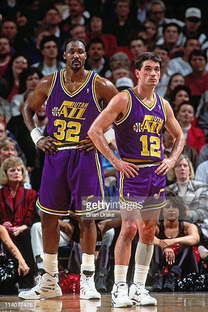 Karl Malone and John Stockton of the Utah Jazz look on at the Veterans Memorial Coliseum in Portland Oregon circa 1994 NOTE TO USER User expressly...