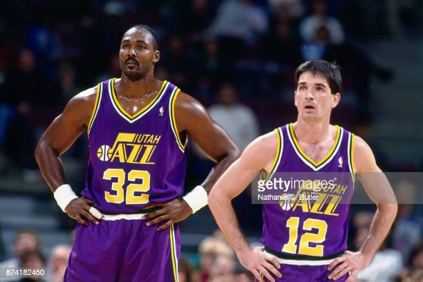 Karl Malone and John Stockton of the Utah Jazz look on during a game played on November 17 1995 at the Palace of Auburn Hills in Auburn Hills...