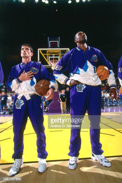 Karl Malone and John Stockton of the Utah Jazz stand for the anthem during Game Three of the Western Conference Semifinals as part of the 1997 NBA...