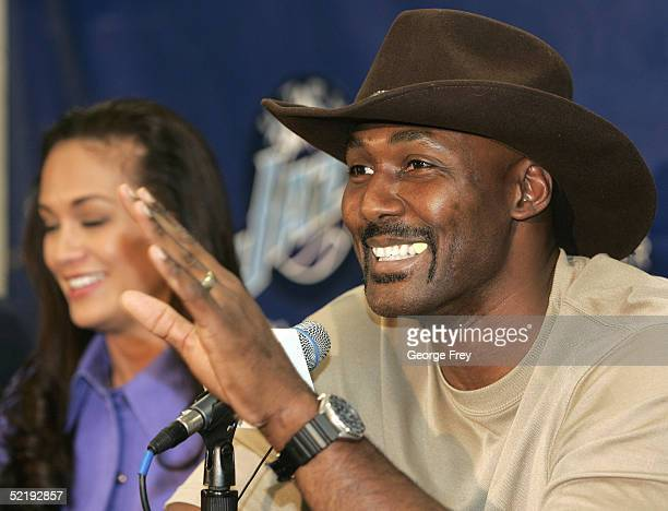 Karl Malone gestures as he announces his retirement from playing NBA basketball as his wife Kay listens on February 13 2005 at the Delta Center in...