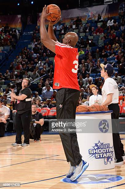 Karl Malone of Team Durant of the western conference shoots during the Sears Shooting Stars Competition on State Farm AllStar Saturday Night as part...