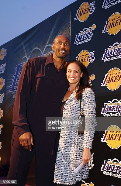 Karl Malone of the Los Angeles Lakers and his wife Kay arrive at the Lakers' Youth Fundraiser held at the Barker Hangar on April 82004 in Santa...