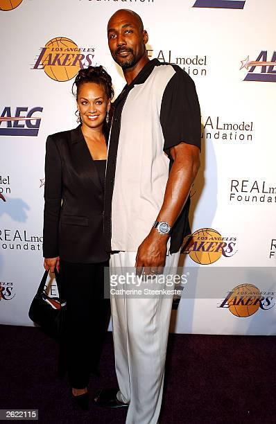 Karl Malone of the Los Angeles Lakers and his wife Kay arriving at the Shaq hosting a night of preseason party to benefit the Lakers Youth Foundation...