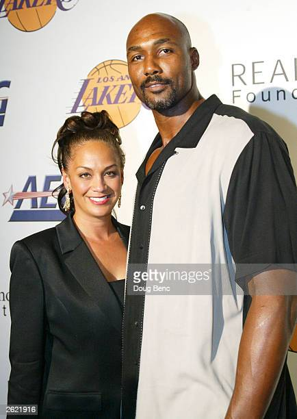 Karl Malone of the Los Angeles Lakers and his wife Kay pose during a special night of partying to benefit the Lakers Youth Foundation hosted by...