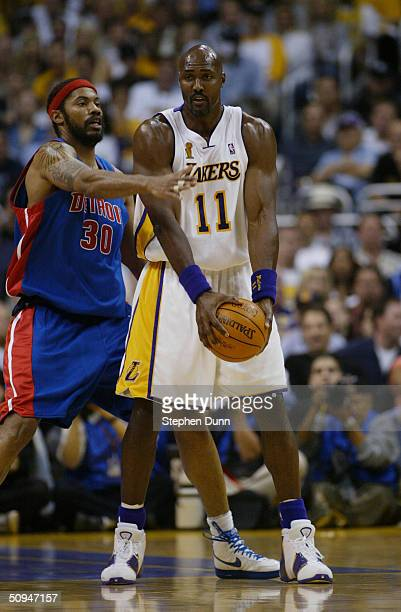 Karl Malone of the Los Angeles Lakers is defended by Rasheed Wallace of the Detroit Pistons in Game One of the 2004 NBA Finals at Staples Center on...
