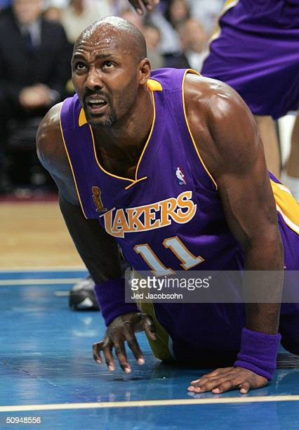 Karl Malone of the Los Angeles Lakers reacts after a play against the Detroit Pistons during the second quarter of game three of the 2004 NBA Finals...