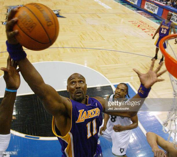 Karl Malone of the Los Angeles Lakers rebounds in the second half against the Minnesota Timberwolves in Game one of the Western Conference Finals...