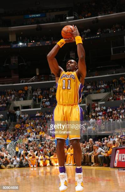 Karl Malone of the Los Angeles Lakers shoots against the Minnesota Timberwolves defense in Game four of the Western Conference Finals during the 2004...