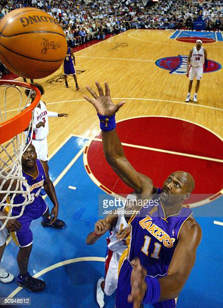 Karl Malone of the Los Angeles Lakers tips in a shot over Richard Hamilton of the Detroit Pistons during the first quarter of Game three of the 2004...