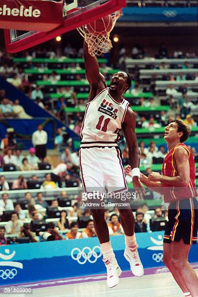 Karl Malone of the United States National Team dunks the ball during a game against Spain in the 1992 Summer Olympics at Pavelló Olímpic de Badalona...