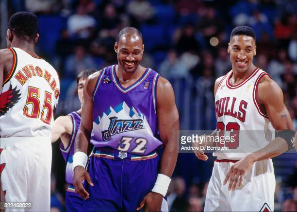 Karl Malone of the Utah Jazz and Scottie Pippen of the Chicago Bulls smile during the 1997 AllStar Game on February 9 1997 at Gund Arena in Cleveland...