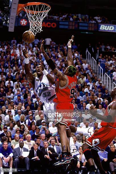 Karl Malone of the Utah Jazz attempts a layup against Dennis Rodman of the Chicago Bulls in Game Six of the 1998 NBA Finals at the Delta Center on...
