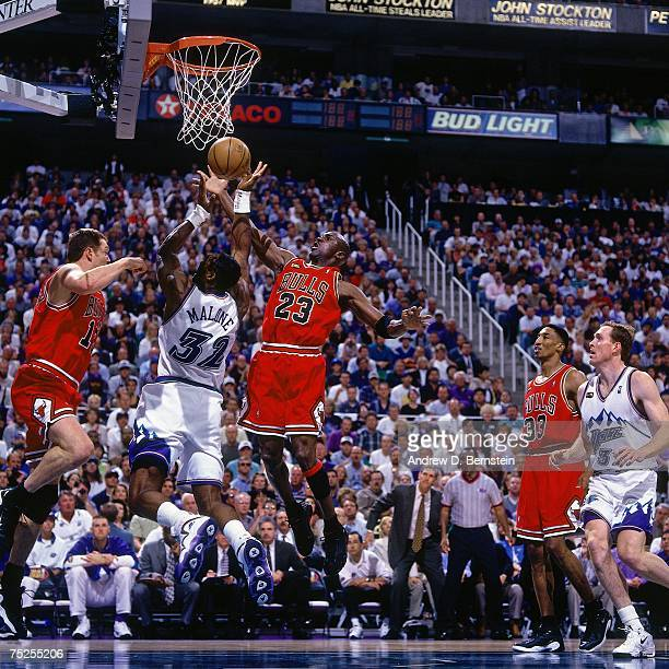 Karl Malone of the Utah Jazz attempts a layup against Michael Jordan of the Chicago Bulls in Game Six of the 1998 NBA Finals at the Delta Center on...