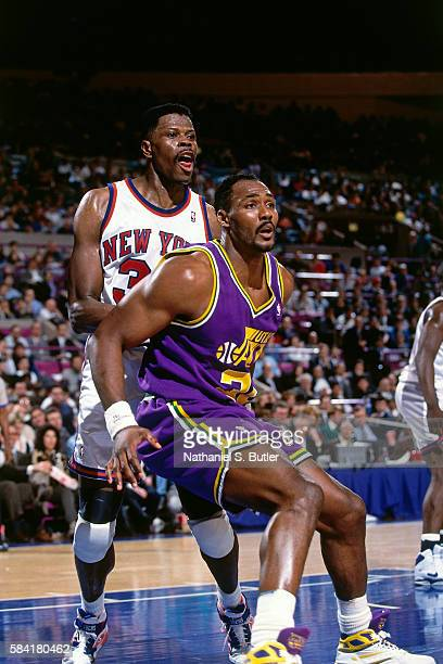Karl Malone of the Utah Jazz boxes out Patrick Ewing of the New York Knicks during a game played circa 1993 at Madison Square Garden in New York City...