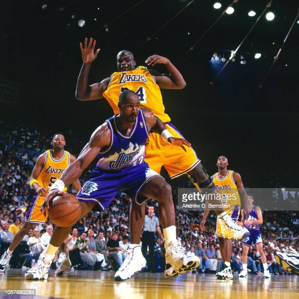 Karl Malone of the Utah Jazz dribbles during Game Four of the Western Conference Semifinals as part of the 1997 NBA Playoffs on May 10 1997 at the...