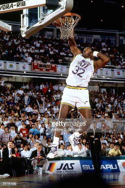 Karl Malone of the Utah Jazz drives in for a dunk against the Phoenix Suns during the 1990 Japan Games at the Tokyo Dome in Tokyo Japan NOTE TO USER...