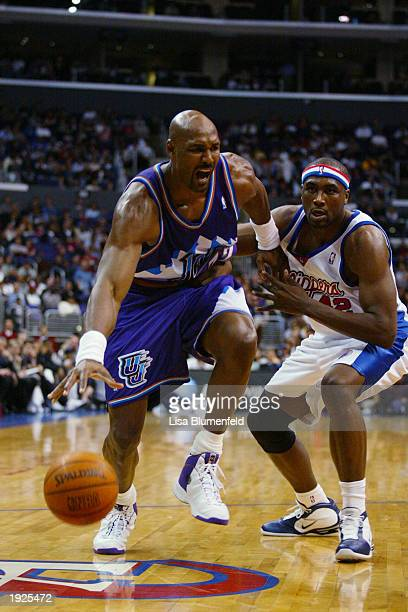 Karl Malone of the Utah Jazz drives past Elton Brand of the Los Angeles Clippers during the game at Staples Center on April 1 2003 in Los Angeles...