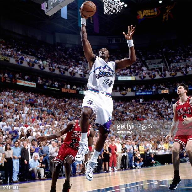Karl Malone of the Utah Jazz drives to the basket for a layup against the Chicago Bulls during Game Four of the 1997 NBA Finals at the Delta Center...