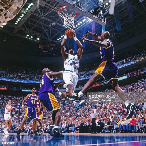 Karl Malone of the Utah Jazz dunks against Shaquille O'Neal of the Los Angeles Lakers during Game Two of the Western Conference Semifinals as part of...