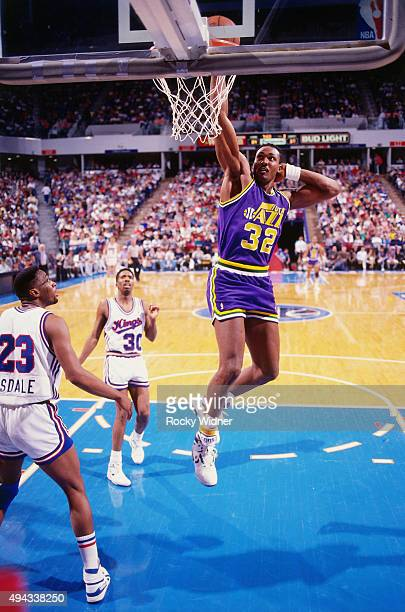Karl Malone of the Utah Jazz dunks against the Sacramento Kings circa 1989 at Arco Arena in Sacramento California NOTE TO USER User expressly...