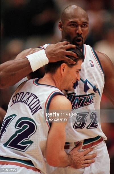 Karl Malone of the Utah Jazz gives John Stockton a hug after they beat the Minnesota Timberwolves in Salt Lake City UT 06 November 2000 The Jazz...