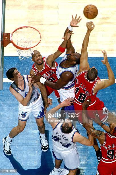 Karl Malone of the Utah Jazz goes up for a rebound against Ron Harper and Brian Williams of the Chicago Bulls in Game Three of the 1997 NBA Finals at...
