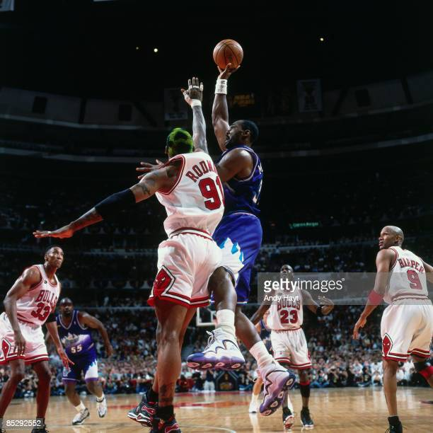 Karl Malone of the Utah Jazz goes up for a shot against Dennis Rodman of the Chicago Bulls during Game Five of the 1998 NBA Finals played on June 12...