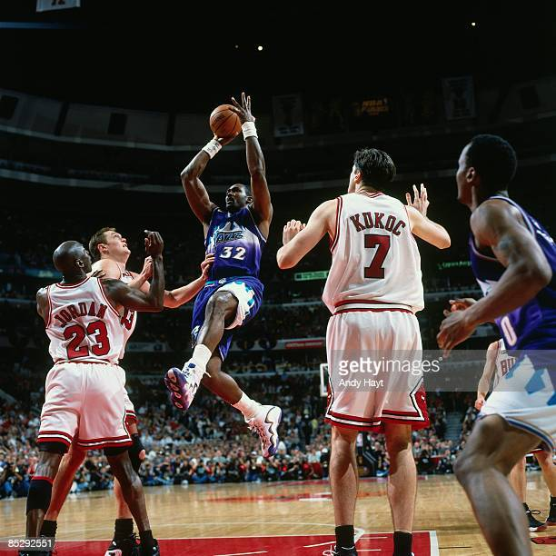 Karl Malone of the Utah Jazz goes up for a shot against Michael Jordan of the Chicago Bulls during Game Five of the 1998 NBA Finals played on June 12...