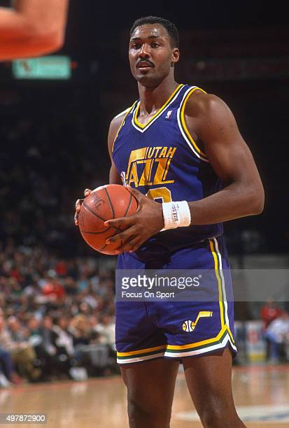 Karl Malone of the Utah Jazz in looks to pass the ball against the Washington Bullets during an NBA basketball game circa 1989 at the Capital Centre...