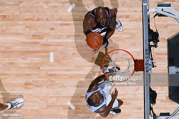 Karl Malone of the Utah Jazz lays up a shot during the game against the Charlotte Hornets on December 2 2000 at Charlotte Coliseum in Charlotte North...
