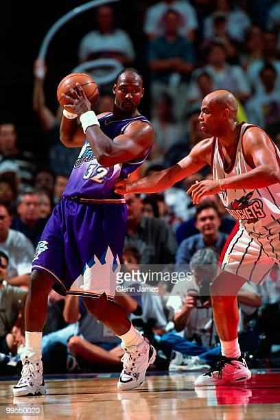 Karl Malone of the Utah Jazz looks to make a move against Charles Barkley of the Houston Rockets in Game Four of the Western Conference Finals during...
