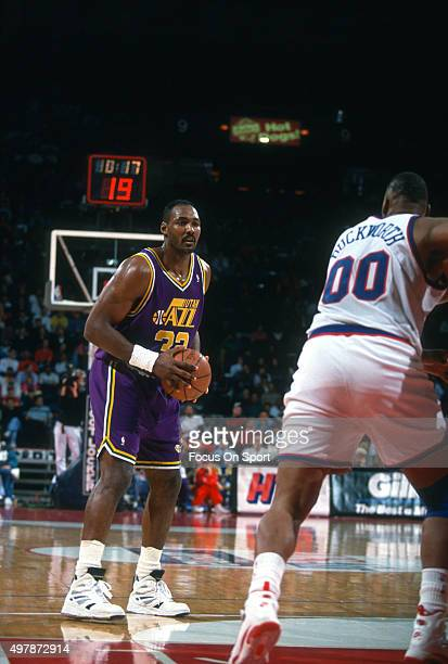 Karl Malone of the Utah Jazz looks to shoot against the Washington Bullets during an NBA basketball game circa 1993 at the US Airways Arena in...
