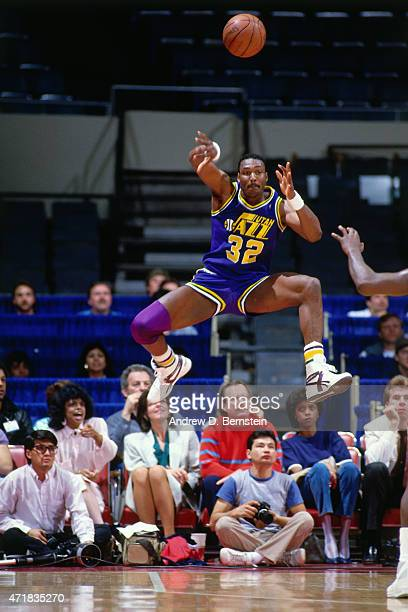 Karl Malone of the Utah Jazz passes the ball against the Los Angeles Lakers circa 1986 at The Forum in Los Angeles CA NOTE TO USER User expressly...