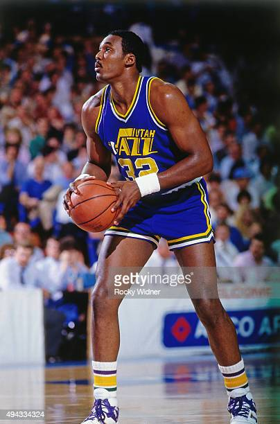 Karl Malone of the Utah Jazz passes the ball against the Sacramento Kings circa 1986 at Arco Arena in Sacramento California NOTE TO USER User...
