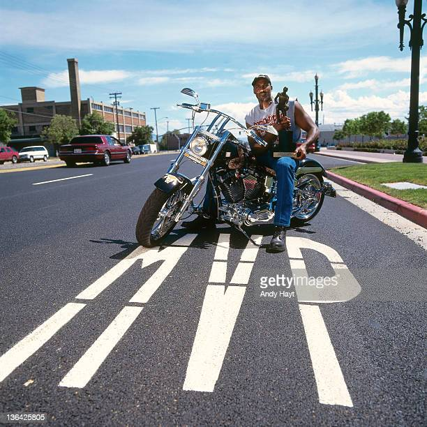 Karl Malone of the Utah Jazz poses for a portrait on his Motor cycle after winning the 1997 MVP award on May 30 1997 in Salt Lake City Utah NOTE TO...