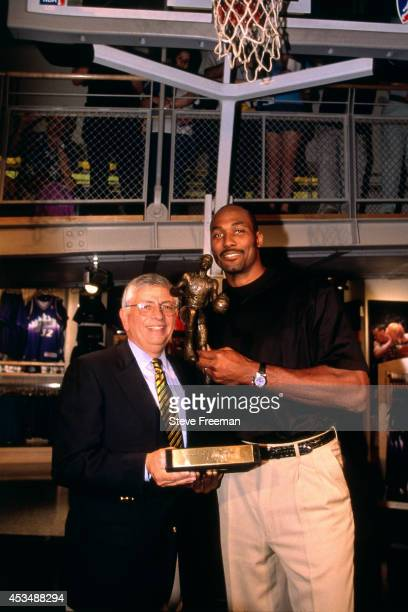 Karl Malone of the Utah Jazz poses for a portrait with NBA Commissioner David Stern circa May 1999 with the MVP trophy in New York City NOTE TO USER...