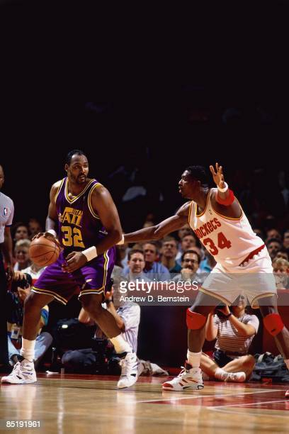 Karl Malone of the Utah Jazz posts up against Hakeem Olajuwon of the Houston Rockets during Game Two of the Western Conference Finals played on May...