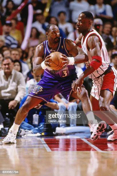 Karl Malone of the Utah Jazz posts up against Kevin Willis of the Houston Rockets during Game Six of the Western Conference Finals on May 29 1997 at...