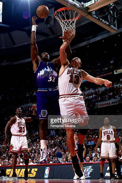 Karl Malone of the Utah Jazz rebounds against Luc Longley of the Chicago Bulls in Game Five of the 1998 NBA Finals at the United Center on June 12...