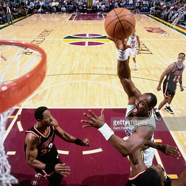 Karl Malone of the Utah Jazz shoots a baby hookshot in the lane against the Miami Heat at the Delta Center circa 1996 in Salt Lake City, Utah. NOTE...