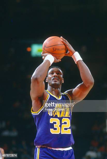Karl Malone of the Utah Jazz shoots a free throw against the Washington Bullets during an NBA basketball game circa 1989 at the Capital Centre in...