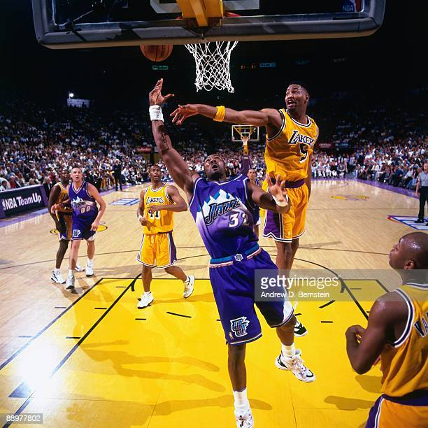 Karl Malone of the Utah Jazz shoots a layup against Robert Horry of the Los Angeles Lakers in Game Three of the Western Conference Semifinals during...