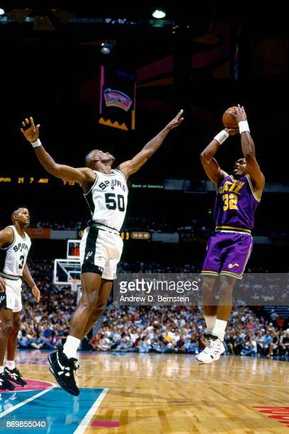 Karl Malone of the Utah Jazz shoots against David Robinson of the San Antonio Spurs during Game One of the 1994 Western Conference Quarterfinals...