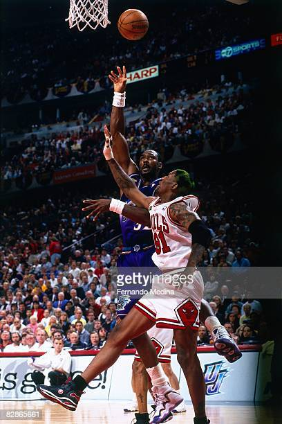 Karl Malone of the Utah Jazz shoots against Dennis Rodman of the Chicago Bulls in Game Five of the 1998 NBA Finals at the United Center on June 12...
