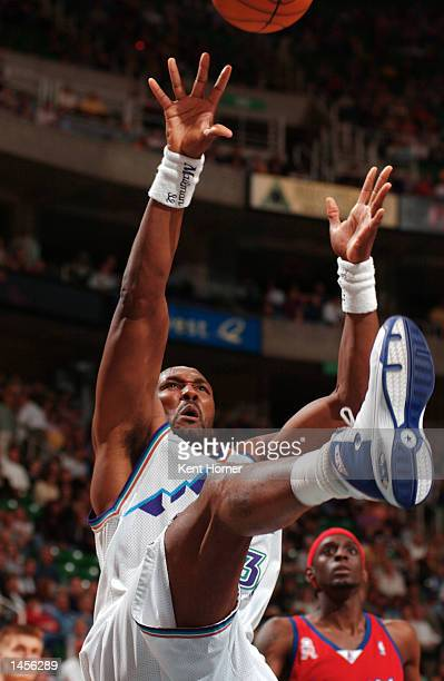 Karl Malone of the Utah Jazz shows some sole while putting up the shot against the Los Angeles Clippers at the Delta Center in Salt Lake City Utah...