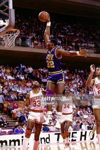 Karl Malone of the Utah Jazz soars to the basket for a slam dunk against the Houston Rockets at the Summit circa 1988 in Houston Texas NOTE TO USER...