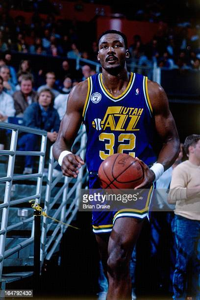 Karl Malone of the Utah Jazz walks to the court during a game played circa 1988 at the Seattle Coliseum in Seattle Washington NOTE TO USER User...