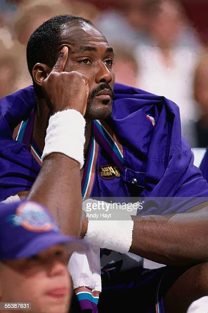 Karl Malone of the Utah Jazz watches from the bench against the Chicago Bulls during Game three of the 1998 NBA Finals at United Center on June 7...