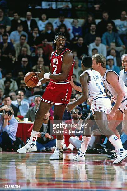 Karl Malone of the West AllStars handles the ball against the East AllStars circa 1988 during the 1988 NAllStar Weekend at Chicago Stadium in Chicago...
